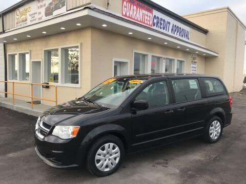 2014 Dodge Grand Caravan for sale at Suarez Auto Sales in Port Huron MI