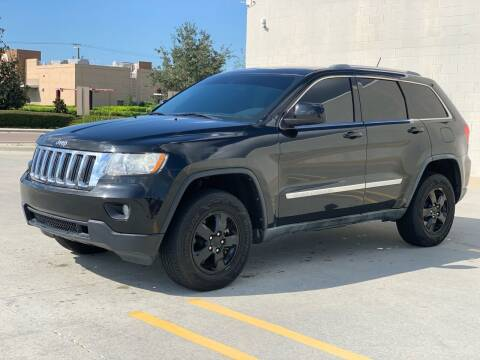 2012 Jeep Grand Cherokee for sale at Santos Autos in Bradenton FL