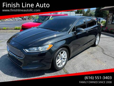 2014 Ford Fusion for sale at Finish Line Auto in Comstock Park MI