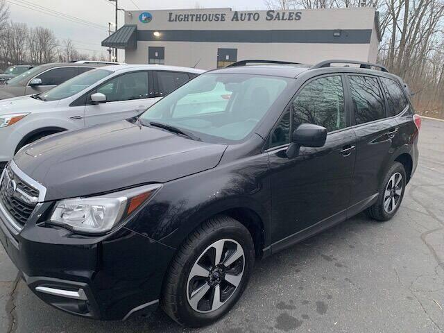 2017 Subaru Forester for sale at Lighthouse Auto Sales in Holland MI