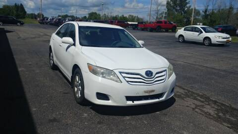 2011 Toyota Camry for sale at Pool Auto Sales Inc in Spencerport NY