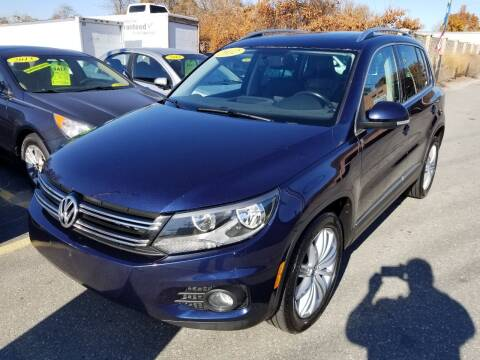 2012 Volkswagen Tiguan for sale at Howe's Auto Sales in Lowell MA