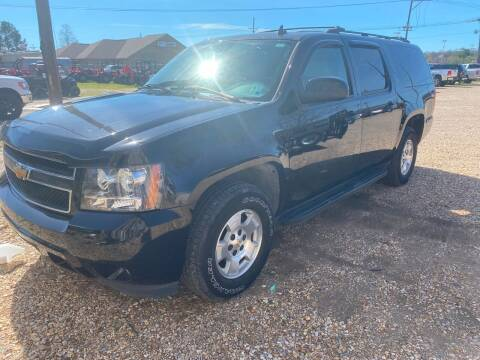 2007 Chevrolet Suburban for sale at Community Auto Specialist in Gonzales LA