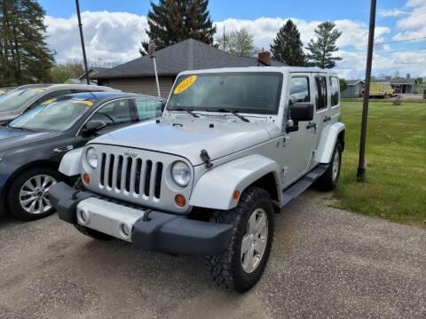 2012 Jeep Wrangler Unlimited for sale at Clare Auto Sales, Inc. in Clare MI