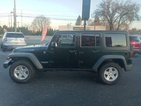 2011 Jeep Wrangler Unlimited for sale at L&T Auto Sales in Three Rivers MI