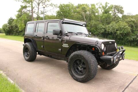 2013 Jeep Wrangler Unlimited for sale at Clear Lake Auto World in League City TX