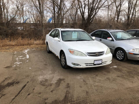 2004 Toyota Camry for sale at BARNES AUTO SALES in Mandan ND