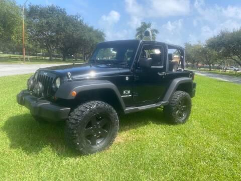 2009 Jeep Wrangler for sale at BIG BOY DIESELS in Fort Lauderdale FL