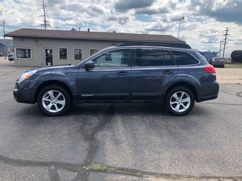 2014 Subaru Outback for sale at Mike's Budget Auto Sales in Cadillac MI