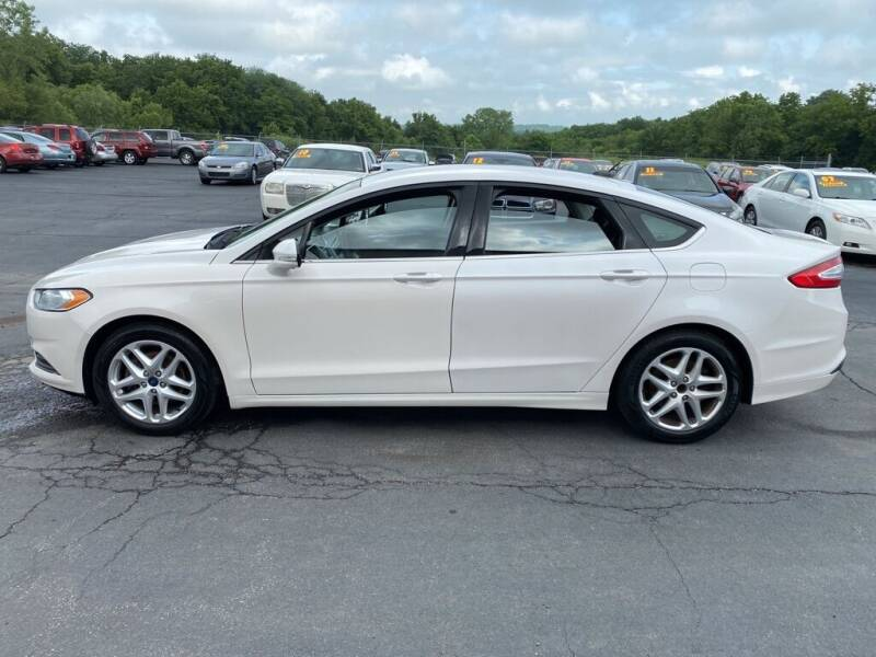 2016 Ford Fusion for sale at CARS PLUS CREDIT in Independence MO