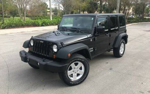 2013 Jeep Wrangler Unlimited for sale at FIRST FLORIDA MOTOR SPORTS in Pompano Beach FL
