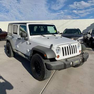 2013 Jeep Wrangler Unlimited for sale at Auto Source in Banning CA