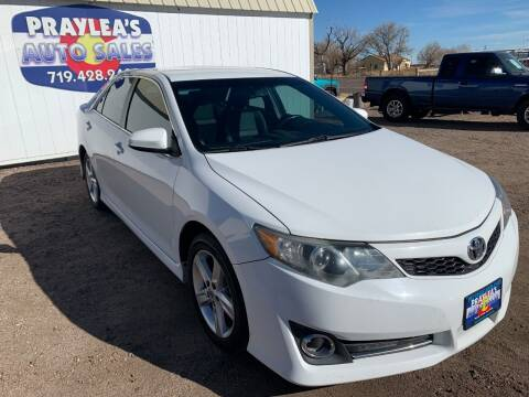 2013 Toyota Camry for sale at Praylea's Auto Sales in Peyton CO