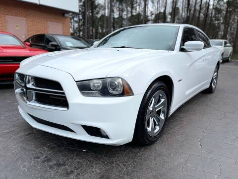 2014 Dodge Charger for sale at Magic Motors Inc. in Snellville GA