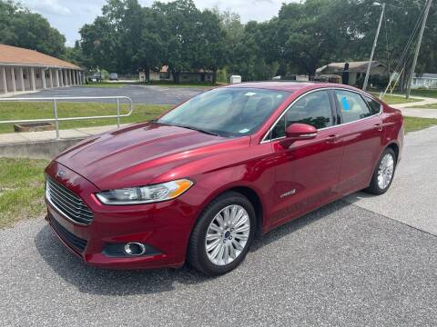 2013 Ford Fusion Hybrid for sale at P J Auto Trading Inc in Orlando FL