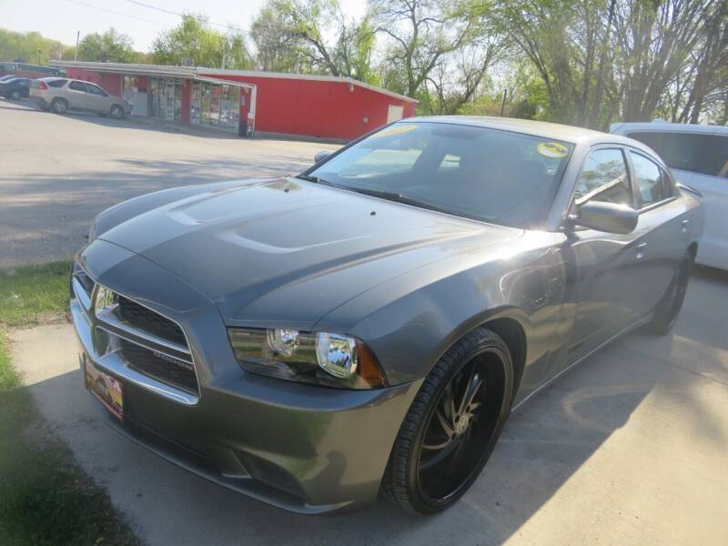 2012 Dodge Charger for sale at Azteca Auto Sales LLC in Des Moines IA