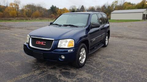 2004 GMC Envoy for sale at Caruzin Motors in Flint MI