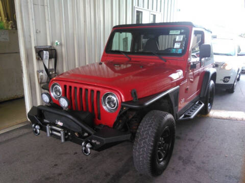 2002 Jeep Wrangler for sale at SAVORS AUTO CONNECTION LLC in East Liverpool OH
