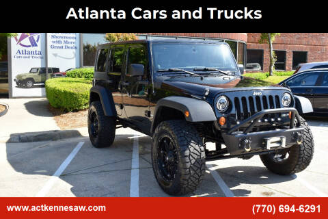 2012 Jeep Wrangler Unlimited for sale at Atlanta Cars and Trucks in Kennesaw GA