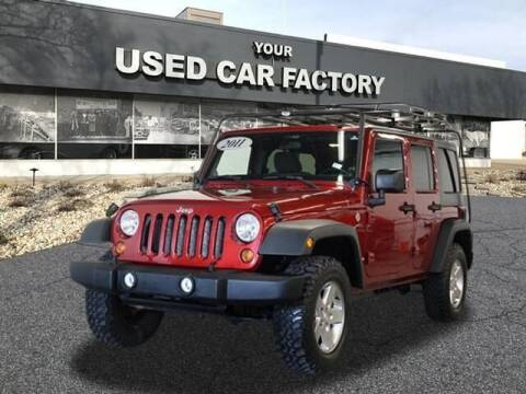 2011 Jeep Wrangler Unlimited for sale at JOELSCARZ.COM in Flushing MI