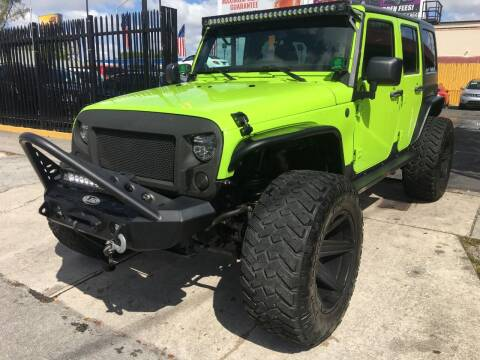 2012 Jeep Wrangler Unlimited for sale at AUTO ALLIANCE LLC in Miami FL