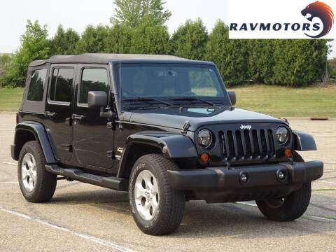 2013 Jeep Wrangler Unlimited for sale at RAVMOTORS in Burnsville MN