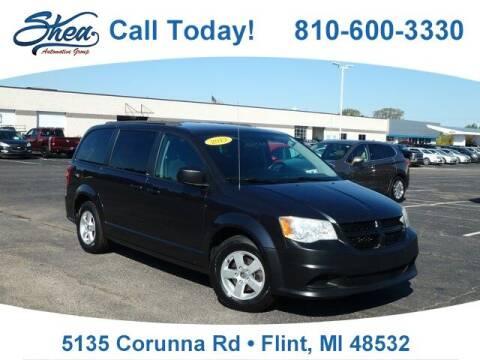 2013 Dodge Grand Caravan for sale at Erick's Used Car Factory in Flint MI