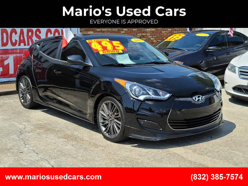 2013 Hyundai Veloster for sale at Mario's Used Cars - South Houston Location in South Houston TX