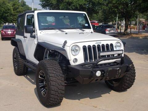2015 Jeep Wrangler for sale at Don Herring Mitsubishi in Plano TX