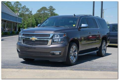 2016 Chevrolet Suburban for sale at STRICKLAND AUTO GROUP INC in Ahoskie NC