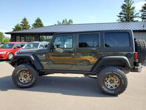 2015 Jeep Wrangler Unlimited for sale at ROSSTEN AUTO SALES in Grand Forks ND