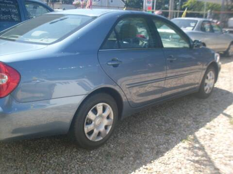 2004 Toyota Camry for sale at Flag Motors in Islip Terrace NY