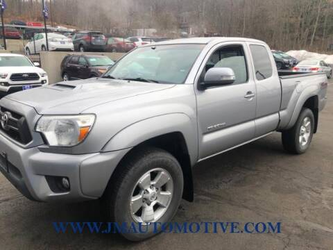 2015 Toyota Tacoma for sale at J & M Automotive in Naugatuck CT