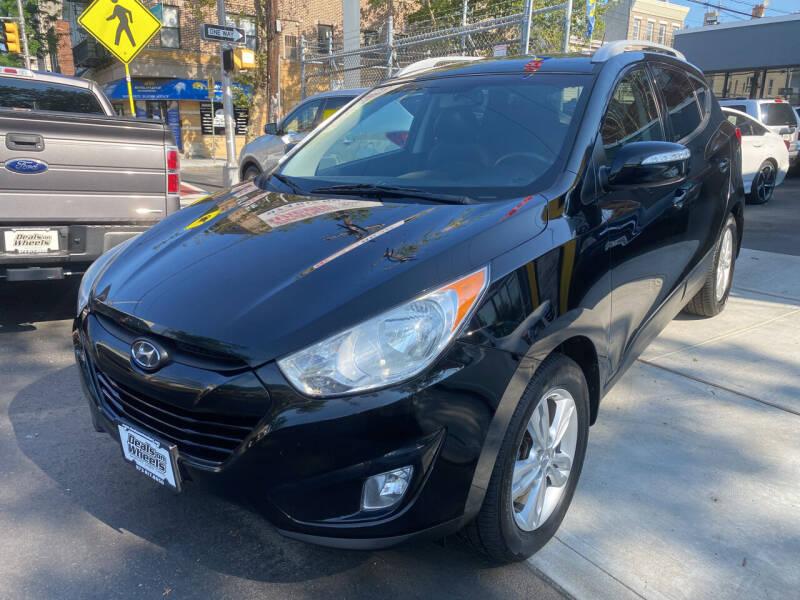 2013 Hyundai Tucson for sale at DEALS ON WHEELS in Newark NJ
