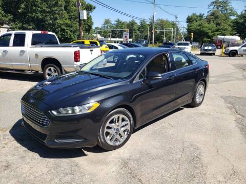 2013 Ford Fusion for sale at Topham Automotive Inc. in Middleboro MA
