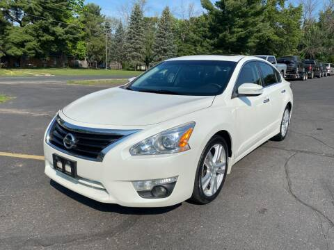 2015 Nissan Altima for sale at Northstar Auto Sales LLC in Ham Lake MN