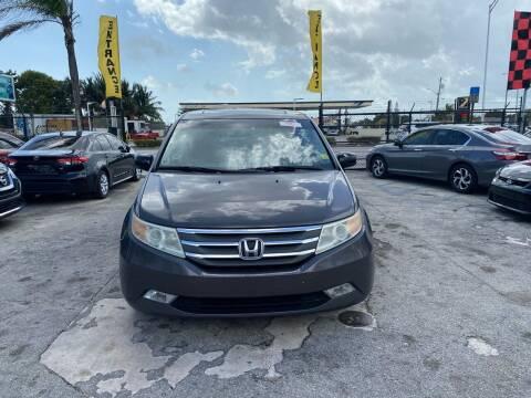 2011 Honda Odyssey for sale at America Auto Wholesale Inc in Miami FL