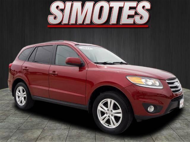 2012 Hyundai Santa Fe for sale at SIMOTES MOTORS in Minooka IL