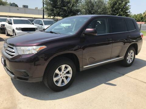2013 Toyota Highlander for sale at AMIGO USED CARS in Houston TX