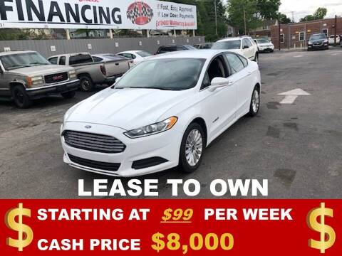 2014 Ford Fusion Hybrid for sale at Auto Mart USA in Kansas City MO