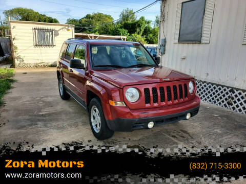 2014 Jeep Patriot for sale at Zora Motors in Houston TX