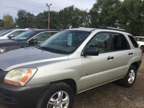 2006 Kia Sportage for sale at BARNES AUTO SALES in Mandan ND