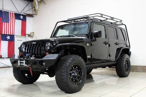 2012 Jeep Wrangler Unlimited for sale at ROADSTERS AUTO in Houston TX
