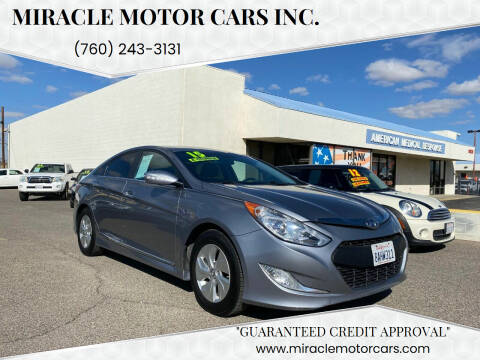 2015 Hyundai Sonata Hybrid for sale at Miracle Motor Cars Inc. in Victorville CA