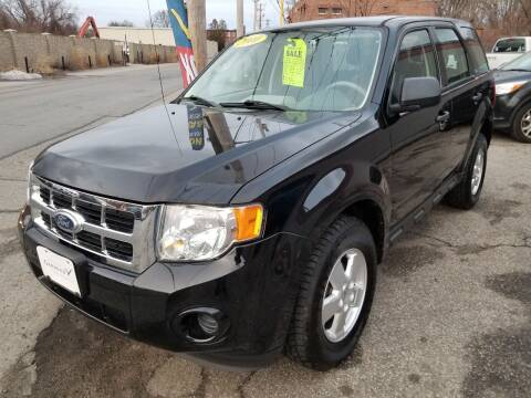 2010 Ford Escape for sale at Howe's Auto Sales in Lowell MA
