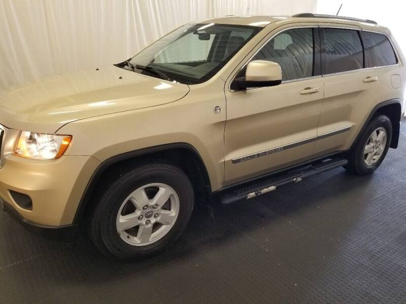 2011 Jeep Grand Cherokee for sale at Rick's R & R Wholesale, LLC in Lancaster OH