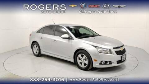 2014 Chevrolet Cruze for sale at ROGERS  AUTO  GROUP in Chicago IL