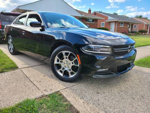 2015 Dodge Charger for sale at Dymix Used Autos & Luxury Cars Inc in Detroit MI
