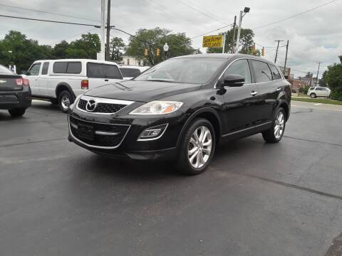 2012 Mazda CX-9 for sale at Sarchione INC in Alliance OH