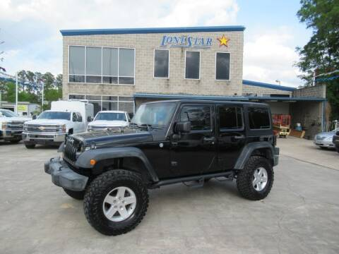 2012 Jeep Wrangler Unlimited for sale at Lone Star Auto Center in Spring TX